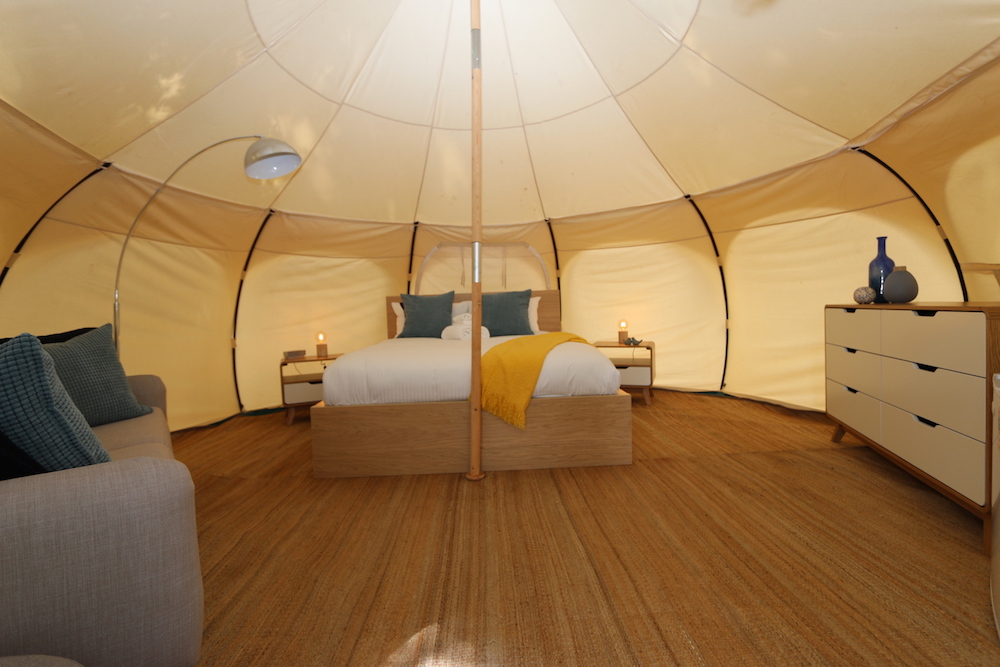 Glamping shot of bed in large tent